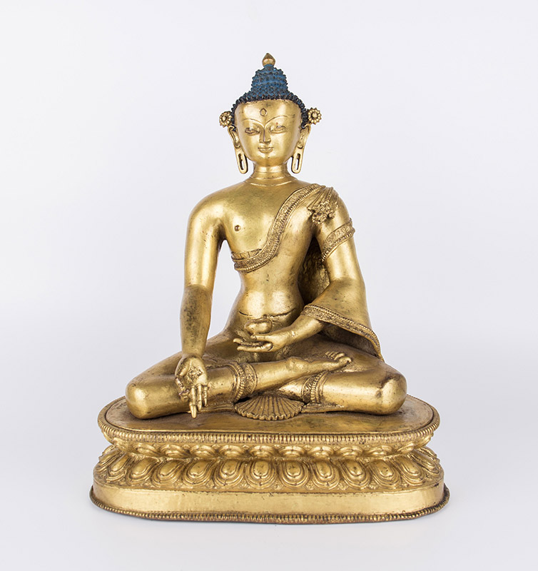Medicine Buddha. c. 14th century, Tibet or Nepal. Gilt copper alloy, 34 cm
