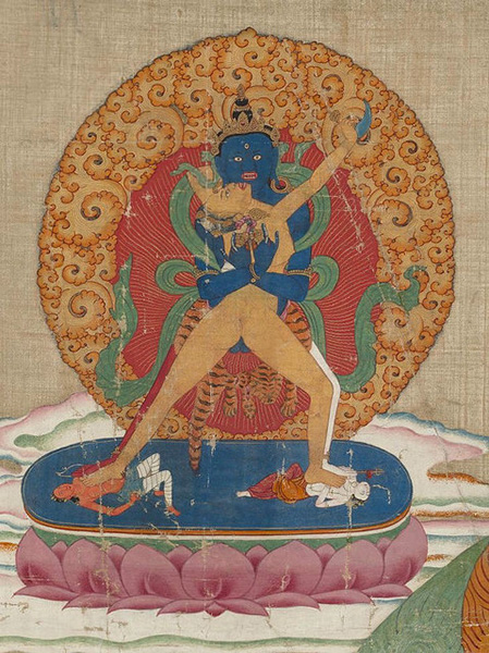 Chakrasambhava coupled with Vajrayogini, representing wisdom and compassion as aspects of the same primal energy. The pose is unusual as Vajrayogini is standing with both of her feet on the ground. Chakrasambhava's legs are white and red. The five elemental colors comprise the composition: blue, white, green yellow red. Tibet, date unknown. From Core of Culture