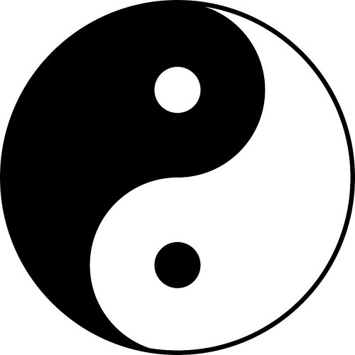 The <em>tai chi</em> symbol, representing the forces of <em>yin</em> and <em>yang</em> in harmonious movement and balance, the seed of each within the other. Traditional. From Core of Culture