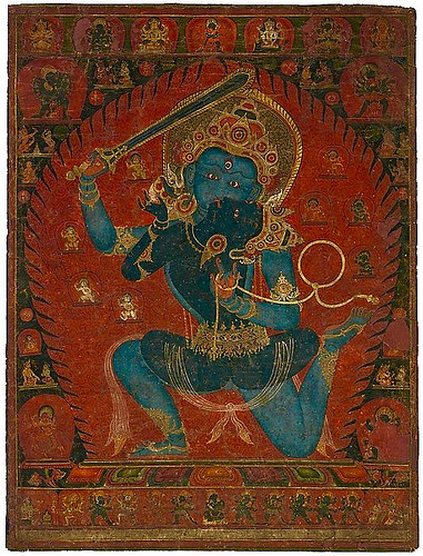Achala, destroyer of ignorance, in a martial dance with his dakini. Early 16th century, Nepal. Courtesy Himalayan Art Resources